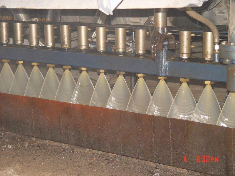 Synchronous asphalt chip sealer