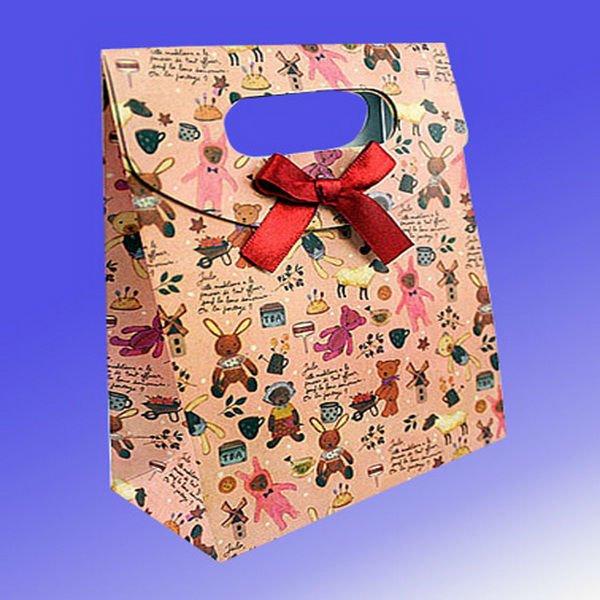 Como hacer bolsas de papel para regalo - Como hacer bolsas de regalo ...