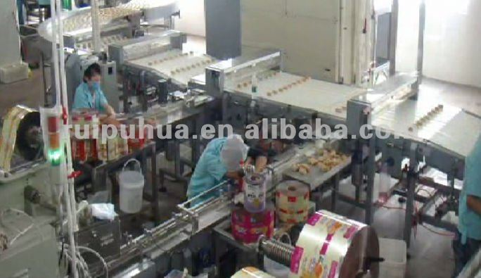 Automatic plastic film wrapping equipment for cracker