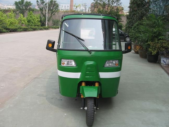 Green BAJAJ MOTORCYCLE THREE WHEEL PASSENGER CAR
