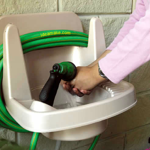 Hook up water hose to sink