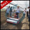 pequeña máquina sembradora de semillas de hortalizas de mano de obra