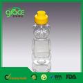 تجار العسل التعبئة البلاستيكية الفارغة زجاجة تحمل الشكل
