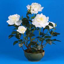 grandes cabezas de las flores artificiales rosa blanca