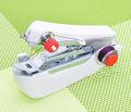 china alibaba rápida reparación de ropa de uso en el hogar de mano mini máquina de coser