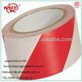 La parte superior- venta de color rojo y blanco de la cinta warnning