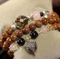Pulsera cristal natural de perla con zorro brillante