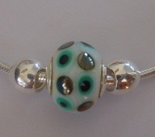 Modular glass beads with 92. 5 silver core