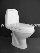 Two-piece toilet of white ceramic with seat cover