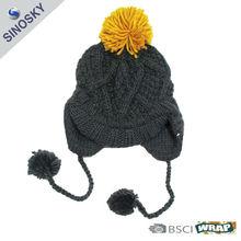 winter knit pom pom beanie with tassel