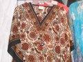 Roupas étnicas como kaftan , s kurta , túnica , e blusas