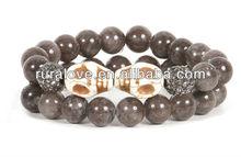 Unique 2 set skull bracelet with gray stone