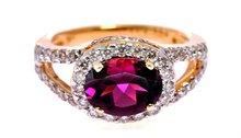 18k Gold Rhodolite ring with shimmering diamonds