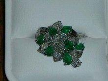 Platinum Lady's Cast Diamond And Emerald Ring