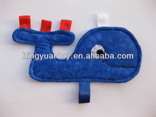 blue whale crinkle toy with red ribbon tags on tail