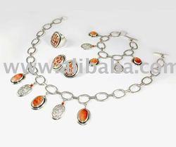 Set de Collar, aretes, pulsera y anillo de plata con spondylus