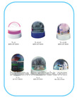 Plastic liquid LED snow globe
