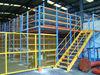 Pallet rack supported steel mezzanine floor
