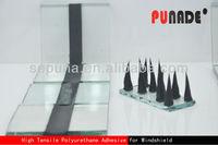 Polyurethane stained laminated glass adhesive