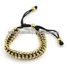 Gold alloy braided bracelet black nylon