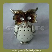 con el metal de cerámica búho de la decoración