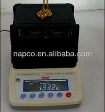 Napco gold test for karat, percentage, density in jewellery shop