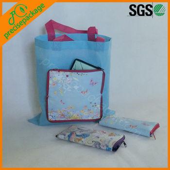 women folding zippered shopping bag