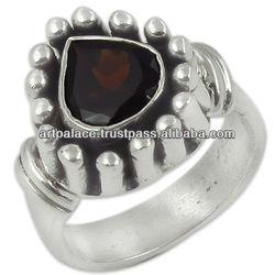 Elegant fancy sterling silver rings with Garnet
