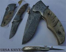 Custom damascus folder knife