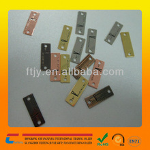 China made custom logo engraved metal swing tags for clothing metal cloth swing tag