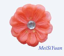 Orange fabric flower corsage with rhinestone