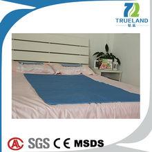 Slim mattress on bed for summer cooling