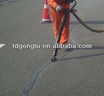 Rubberized hot pour asphalt crack filler