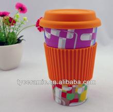 Travel mug with customized logo and silicone lid