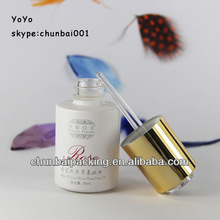 white glass dropper bottles for cosmetic packaging with luxury caps