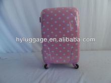 4 wheels pink polka dot luggage