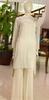 white and golden Latest Pakistani designer partywear semi formal short kurta dress with white plazzo