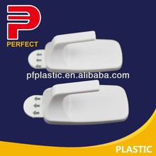 White plastic adhesive back hook