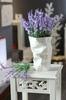 white ceramic porcelain paper bag vases