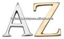 wooden brass alphabet board