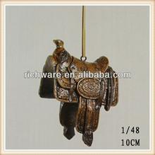 Polyresin hanging western saddle ornament