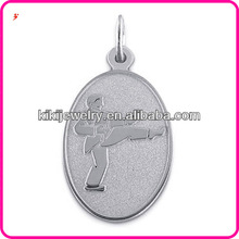 a man practice martial arts on oval disc silver charm