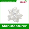 White plastic ribbon star gift bow for wedding