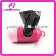 China Yiwu pink plastic capsule shaped dog trash bag dispenser