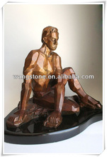 Naked muscle man casting bronze sculpture show power