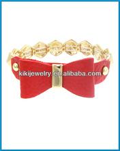 Fashion costume jewelry red leather bow fake gold elastic bracelet