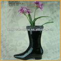 Del zapato de cerámica florero