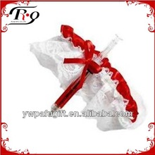 red and white nurse garter and syringe pen