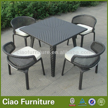 Outdoor dining table with four chairs lower chair
