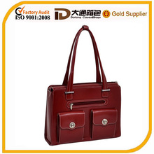 Elegant checkpoint-friendly solid color laptop bag with magnetic snaps for lady
